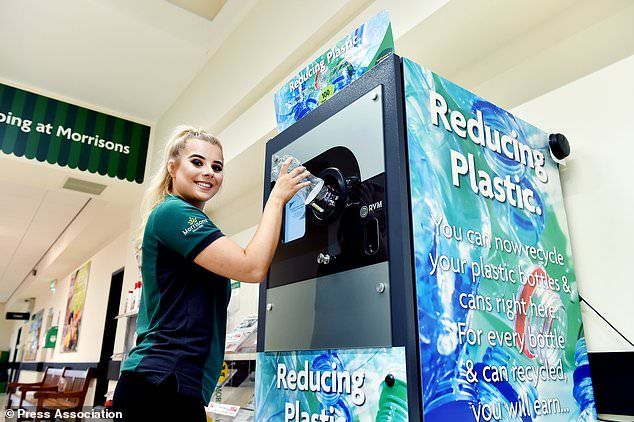 Wm Morrisons Supermarkets is trialing a reverse vending machine at the store by the checkouts for customers to insert empty plastic bottles and receive Morrisons points back. 11th July 2018